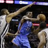 Oklahoma Thunder\'s Kevin Durant (35) looks to pass the ball as San Antonio Spurs\' Tim Duncan (21) and Boris Diaw, right, of France, defend during the third quarter of an NBA basketball game, Thursday, Nov. 1, 2012, in San Antonio. (AP Photo/Eric Gay) ORG XMIT: TXEG111