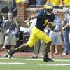 Photo - Michigan wide receiver Devin Funchess (1)  rushes for a touchdown after making a catch in the first quarter of an NCAA college football game against Appalachian State in Ann Arbor, Mich., Saturday, Aug 30, 2014. (AP Photo/Tony Ding)