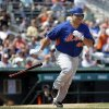 Photo - New York Mets' Bartolo Colon singles on a ground ball to score teammate Wilmer Flores in the sixth inning of an exhibition spring training baseball game against the Miami Marlins, Saturday, March 22, 2014, in Jupiter, Fla. (AP Photo/David Goldman)