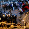 Egyptian protesters pull barbed wires during a protest in front of the presidential palace in Cairo, Egypt, Friday, Jan. 25, 2013. Two years after Egypt\'s revolution began, the country\'s schism was on display Friday as the mainly liberal and secular opposition held rallies saying the goals of the pro-democracy uprising have not been met and denouncing Islamist President Mohammed Morsi. (AP Photo/Amr Nabil) ORG XMIT: AMR114