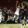 Photo - UCLA guard Nirra Fields (21) puts up a shot as UCLA's Atonye Nyingifa, left, and Colorado guard Ashley Wilson, second from left, stand near in the first half of an NCAA college basketball game in the Pac-12 women's tournament, Thursday, March 6, 2014, in Seattle. (AP Photo/Ted S. Warren)