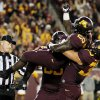 Photo -   Minnesota running back Donnell Kirkwood (20) celebrates with teammates after scoring a touchdown in the first half of an NCAA college football game against Syracuse in Minneapolis, Saturday, Sept. 22, 2012. (AP Photo/Andy King)
