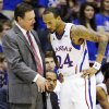 Kansas head coach Bill Self talks with guard Travis Releford (24) during the first half of an NCAA college basketball game against Oklahoma in Lawrence, Kan., Saturday, Jan. 26, 2013. (AP Photo/Orlin Wagner) ORG XMIT: KSOW104