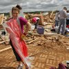 Miranda Lewis makes the best of a bad situation as she models a dress that was undamaged by Tuesday\'s tornado that destroyed her family\'s home west of El Reno, Wednesday, May 25, 2011. Photo by Chris Landsberger, The Oklahoman