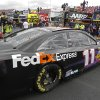NASCAR Sprint Cup series driver Denny Hamlin (11) pulls out of the garage area during practice for Sunday\'s auto race at the Talladega Superspeedway in Talladega, Ala., Friday, May 3, 2013. (AP Photo/Butch Dill)