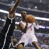 Los Angeles Clippers\' Chris Paul, right, passes the ball as he is defended by Brooklyn Nets\' Andray Blatche during the first half of an NBA basketball game on Saturday, Nov. 16, 2013, in Los Angeles. (AP Photo/Jae C. Hong)
