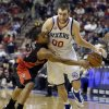 Toronto Raptors\' Kyle Lowry, left, tries to steal the ball from Philadelphia 76ers\' Spencer Hawes in overtime of an NBA basketball game, Friday, Jan. 18, 2013, in Philadelphia. Philadelphia won 108-101. (AP Photo/Matt Slocum)