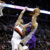 Photo - Phoenix Suns guard Goran Dragic, right, of Slovenia, goes to the basket against Portland Trail Blazers forward Nicolas Batum, of France, during the first quarter of an NBA basketball game in Portland, Ore., Tuesday, Feb. 19, 2013. (AP Photo/Don Ryan)