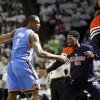 Oklahoma City\'s Serge Ibaka, left, and Royal Ivey slap hands before Game 5 of the Western Conference Finals between the Oklahoma City Thunder and the San Antonio Spurs in the NBA basketball playoffs at the AT&T Center in San Antonio, Monday, June 4, 2012. Photo by Nate Billings, The Oklahoman