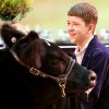 Logan Davis of Newcastle FFA, listens to bids during the auction of his Reserve Grand Champion steer during the Oklahoma Youth Expo Sale of Champions at State Fair Park in Oklahoma City on Monday, March 23, 2008. PHOTO BY JOHN CLANTON, THE OKLAHOMAN ORG XMIT: KOD