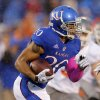 Kansas\' D.J. Beshears (20) rushes during the college football game between Oklahoma State University (OSU) and the University of Kansas (KU) at Memorial Stadium in Lawrence, Kan., Saturday, Oct. 13, 2012. Photo by Sarah Phipps, The Oklahoman