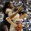 Photo - Cincinnati's Jeanise Randolph, left, guards Connecticut's Breanna Stewart, right, during the first half of an NCAA college basketball game on Sunday, Dec. 29, 2013, in Storrs, Conn. (AP Photo/Jessica Hill)