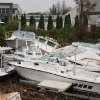 Pleasure boats pile up yards from shore in the wake of superstorm Sandy, Tuesday, Oct. 30, 2012, in the Cliffwood Beach section of Aberdeen, N.J. The storm\'s high winds and the high astronomical tide paired up to rip the boats away from their dock and deposit them on shore. (AP Photo/Peter Hermann, III) ORG XMIT: NYR103