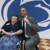 Photo - Penn State football coach James Franklin poses for a photo with Penn State alumna Joan Taylor at Valley Forge Casino, Tuesday, May 13, 2014, in Valley Forge, Pa. (AP Photo/The Philadelphia Daily News, Steven M. Falk) THE EVENING BULLETIN OUT  TV OUT  MAGS OUT  NO SALES