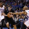 Photo - Minnesota Timberwolves guard Alexey Shved drives past Oklahoma City Thunder guards Jeremy Lamb (11) and guard Derek Fisher (6) during the second quarter of an NBA basketball game in Oklahoma City, Wednesday, Feb. 5, 2014. (AP Photo/Sue Ogrocki)