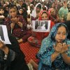 Supporters of Pakistani political party Muttahida Qaumi Movement (MQM), chant prayers in support of 14-year-old schoolgirl Malala Yousufzai, who was shot on Tuesday by the Taliban for speaking out in support of education for women, at the (MQM)\' headquarter in Karachi, Pakistan, Wednesday, Oct. 10, 2012. Pakistani doctors successfully removed a bullet Wednesday from the neck of a 14-year-old girl who was shot by the Taliban for speaking out in support of education for women, a government minister said. Writing on the poster under Malala\'s picture read,
