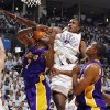 GAME FOUR / L.A. LAKERS: Oklahoma City\'s Serge Ibaka (9) fouls Lamar Odom (7) of L.A. next to Andrew Bynum (17) during the NBA basketball game between the Los Angeles Lakers and the Oklahoma City Thunder in the first round of the NBA playoffs at the Ford Center in Oklahoma City, Saturday, April 24, 2010. Photo by Nate Billings, The Oklahoman ORG XMIT: KOD