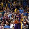 Fans cheer after Lakers\' Kobe Bryant (24) is called for a charge during the NBA basketball game between the Oklahoma City Thunder and the Los Angeles Lakers, Sunday, Feb. 27, 2011, at the Oklahoma City Arena.Photo by Sarah Phipps, The Oklahoman
