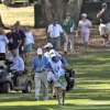 PGA Tour official Gary Young, left, in cart, follows Kevin Na, right, down the 10th fairway during the third round of the Valspar Championship golf tournament at Innisbrook Saturday, March 15, 2014, in Palm Harbor, Fla. Officials were concerned over slow play. (AP Photo/Chris O\'Meara)