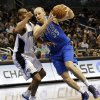 Dallas Mavericks\' Chris Kaman (35) drives to the basket past Orlando Magic\'s Arron Afflalo, left, during the first half of an NBA basketball game, Sunday, Jan. 20, 2013, in Orlando, Fla. (AP Photo/John Raoux)
