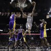 San Antonio Spurs\' Manu Ginobili, front center, of Argentina, drives to the basket between Los Angeles Lakers\' Antawn Jamison (4), Jodie Meeks (20) and Dwight Howard (12) during the second half of Game 1 of their first-round NBA basketball playoff series on Sunday, April 21, 2013, in San Antonio. San Antonio won 91-79. (AP Photo/Eric Gay)