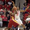 Iowa State\'s Melvin Ejim is defended by Texas Tech\'s Jordan Tolbert (32) during their NCAA college basketball game, Wednesday, Jan. 23, 2013, in Lubbock, Texas. (AP Photo/The Avalanche-Journal, Stephen Spillman) ALL LOCAL TV OUT