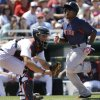 Boston Red Sox\'s Jackie Bradley, Jr. scores on a single by Dustin Pedroia as Minnesota Twins catcher Eric Fryer awaits the throw in from the outfield in the sixth inning of an exhibition spring training baseball game in Fort Myers, Fla., Friday, March 29, 2013. (AP Photo/Elise Amendola)