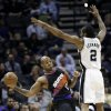 Photo - Phoenix Suns' P.J. Tucker (17) passes around San Antonio Spurs' Kawhi Leonard (2) during the first half of an NBA basketball game, Wednesday, Feb. 27, 2013, in San Antonio. (AP Photo/Eric Gay)