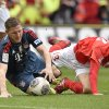 Photo - Mainz's Koo  Ja-cheol  of South Korea, right, and Bayern's Bastian Schweinsteiger  challenge for the ball during  the German Bundesliga soccer match between FSV Mainz 05 and Bayern Munich in Mainz,  Germany, Saturday, March 22, 2014. (AP Photo/Martin Meissner)