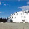 Photo - This undated photo provided by Brad Fisher, shows an urethane igloo in Anchorage, Alaska. The igloo, an embodiment of an Alaska cliche, and a must-stop for tourists heading for Denali National Park and Preserve, is for sale. The 80-foot high structure, erected more than four decades and never completed, sits on a 38-acre site, which is part of the sales package. (AP Photo/Brad Fisher)