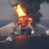FILE - In this April 21, 2010 file image provided by the U.S. Coast Guard, fire boat response crews battle the blazing remnants of the off shore oil rig Deepwater Horizon. British oil company BP said Thursday Nov. 15, 2012 it is in advanced talks with U.S. agencies about settling criminal and other claims from the Gulf of Mexico well blowout two years ago. In a statement, BP said