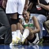 Photo - Notre Dame forward Natalie Achonwa is tended to by a trainer  in the second half of their NCAA women's college basketball tournament regional final game against Baylor at the Purcell Pavilion in South Bend, Ind., Monday, March 31, 2014. Achonwa left the game with the injury. (AP Photo/Paul Sancya)