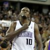 FILE - In this April 13, 2011 file photo, Sacramento Kings center Samuel Dalembert pounds his chest after scoring against the Los Angeles Lakers in the final moments of regulation play, in a NBA basketball game in Sacramento, Calif. Dalembert lost a cousin and several close friends among the estimated 300,000 killed when a magnitude-7.0 earthquake rumbled across his native Haiti on Jan. 12, 2010. Two years later, the NBA\'s only Haitian-born player prays for progress, while tempering his frustration that more hasn\'t been done to rebuild his crippled country.(AP Photo/Rich Pedroncelli)