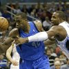 Dallas Mavericks\' Elton Brand, left, goes after a loose ball next to Orlando Magic\'s Glen Davis, right, during the first half of an NBA basketball game, Sunday, Jan. 20, 2013, in Orlando, Fla. (AP Photo/John Raoux)