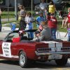 Del City Councilman Bill Giles rides on the back of a classic Mustang during the parade. Del City and eastern Oklahoma County residents lined S. Sunnylane Road to show their support for America\'s military, applauding and cheering participants who marched and rode in the city\'s Armed Forces Day Parade on Saturday morning, May, 19, 2012. The parade worked its way along the Del City route for a little more than an hour. Photo by Jim Beckel, The Oklahoman