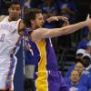 Los Angeles\' Pau Gasol (16) grabs the ball in front of Oklahoma City\'s Thabo Sefolosha (2) during Game 5 in the second round of the NBA playoffs between the Oklahoma City Thunder and the L.A. Lakers at Chesapeake Energy Arena in Oklahoma City, Monday, May 21, 2012. Photo by Bryan Terry, The Oklahoman