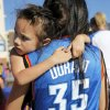 3-year-old Mikenzi Bockhaus, of Oklahoma City, holds on to her mother, Jewlee Syharaj, in Thunder Alley before Game 4 of the Western Conference Finals between the Oklahoma City Thunder and the San Antonio Spurs in the NBA playoffs at the Chesapeake Energy Arena in Oklahoma City, Saturday, June 2, 2012. Photo by Nate Billings, The Oklahoman