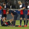 Photo - Paris Saint-Germain's Zlatan Ibrahimovic lies on the ground injured as his teammates and the referee look on during a Champions League quarterfinal first leg soccer match between Paris Saint-Germain and Chelsea at Parc des Princes stadium in Paris, Wednesday, April 2, 2014. (AP Photo/Michel Euler)