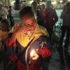 A woman holds a candle as she reacts during a vigil in support of Venezuela\'s President Hugo Chavez in Caracas, Venezuela, Thursday, Dec. 13, 2012. Chavez is recovering favorably despite suffering complications during cancer surgery in Cuba, his vice president Nicolas Maduro said Thursday amid uncertainty over the Venezuelan leader\'s health crisis and the country\'s political future. (AP Photo/Fernando Llano)