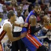 Detroit Pistons center Greg Monroe, right, drives up against Miami Heat forward Shane Battier during the first half of an NBA basketball game, Friday, Jan. 25, 2013 in Miami. (AP Photo/Wilfredo Lee)