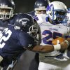 Millwood\'s Sheldon Bulock fights off Star Spencer\'s Shaun Hyche during a high school football game at Star Spencer in Oklahoma City, Friday, September 2, 2011. Photo by Bryan Terry, The Oklahoman