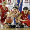 Shattuck\'s Katelyn Cummings, left, and Marissa Galindo fight for a loose ball Erick\'s Makenzie Kelly during the Class B Girls semifinal game of the state high school basketball tournament between Erick and Shattuck at the State Fair Arena., Friday, March 1, 2013. Photo by Sarah Phipps, The Oklahoman