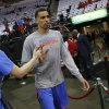 Oklahoma City\'s Thabo Sefolosha is greeted by fans as he walks towards the court before Game 3 in the first round of the NBA playoffs between the Oklahoma City Thunder and the Houston Rockets at the Toyota Center in Houston, Texas, Sat., April 27, 2013. Photo by Bryan Terry, The Oklahoman