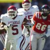 Photo - Unversity of Arkansas' Darren McFadden (5) runs upfield as University of Mississippi's Greg Hardy (86) chases during a college football game in Oxford, Miss., on Saturday, Oct. 20, 2007. (AP Photo/Oxford Eagle, Bruce Newman) ** MAGS OUT NO SALES **                                ORG XMIT: MSOXF103