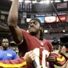 Photo -   Washington Redskins quarterback Robert Griffin III (10) reacts to the crowd after an NFL football game against the New Orleans Saints at Mercedes-Benz Superdome in New Orleans, Sunday, Sept. 9, 2012. The Redskins won 40-32. (AP Photo/Matthew Hinton)