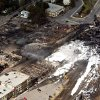 The downtown core lays in ruins as fire fighters continue to water smoldering rubble Sunday, July 7, 2013 in Lac Megantic, Quebec. A runaway train derailed Saturday igniting tanker cars carrying crude oil. (AP Photo/THE CANADIAN PRESS,Ryan Remiorz)