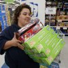 Catrina Bertleson takes items to the register at Toys R Us as they open at 8:00 p.m. on Thanksgiving for Black Friday Sales on Thursday, Nov. 22, 2012, in Norman, Okla. Photo by Steve Sisney, The Oklahoman