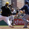 Pittsburgh Pirates\' Travis Snider, left, takes down Milwaukee Brewers\' Carlos Gomez as Brewers\' Rickie Weeks, right, joins a skirmish between the two teams during the third inning of a baseball game in Pittsburgh, Sunday, April 20, 2014. Gomez and Snider were ejected from the game. (AP Photo/Gene J. Puskar)