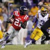 Photo -   Mississippi defensive back Senquez Golson (21) returns one of his two interceptions as LSU wide receiver Odell Beckham (3) pursues in the second half of an NCAA college football game in Baton Rouge, La., Saturday, Nov. 17, 2012. LSU won 41-35. (AP Photo/Gerald Herbert)