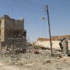This photo taken on Tuesday, July 1, 2014, shows destroyed homes after clashes between fighters of the al-Qaida-inspired Islamic State of Iraq and the Levant and Iraqi security forces in Tikrit, 80 miles (130 kilometers) north of Baghdad, Iraq. The Islamic State of Iraq and the Levant announced this week that it has unilaterally established a caliphate in the areas under its control. It declared the group\'s leader, Abu Bakr al-Baghdadi, the head of its new self-styled state governed by Shariah law and demanded that all Muslims pledge allegiance to him. (AP Photo)
